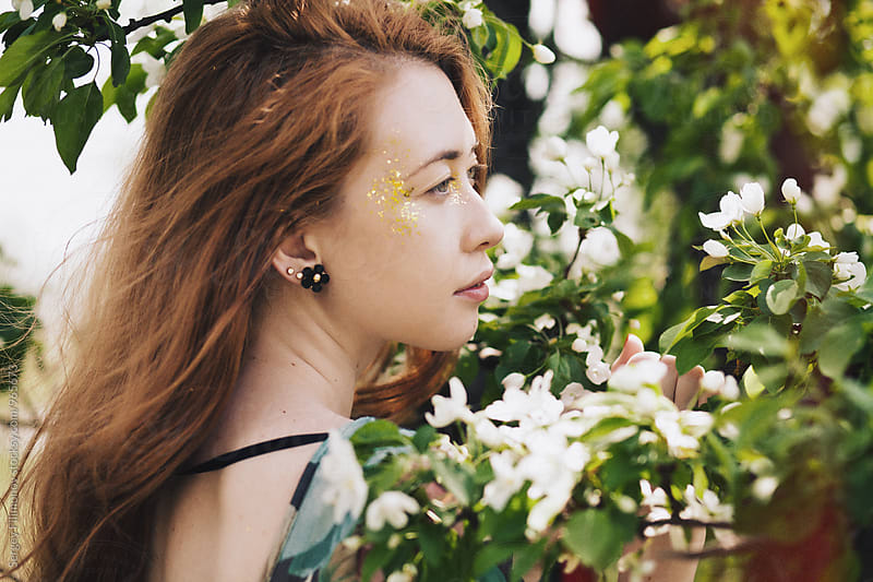Woman posing in flower garden by Sergey Filimonov for Stocksy United