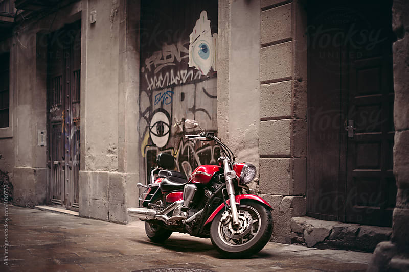 Motorcycle parked in the City by Aila Images for Stocksy United