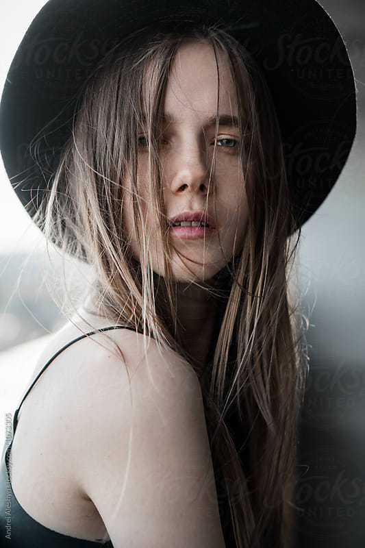 sensual portrait of a beautiful girl in the hat close-up by Andrei Aleshyn for Stocksy United