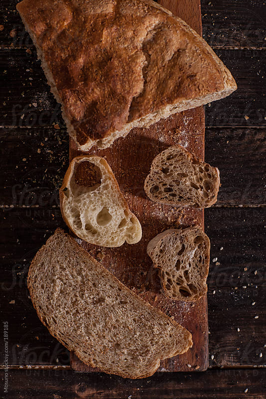 Pieces of Bread on a Cutting Board by Mosuno for Stocksy United