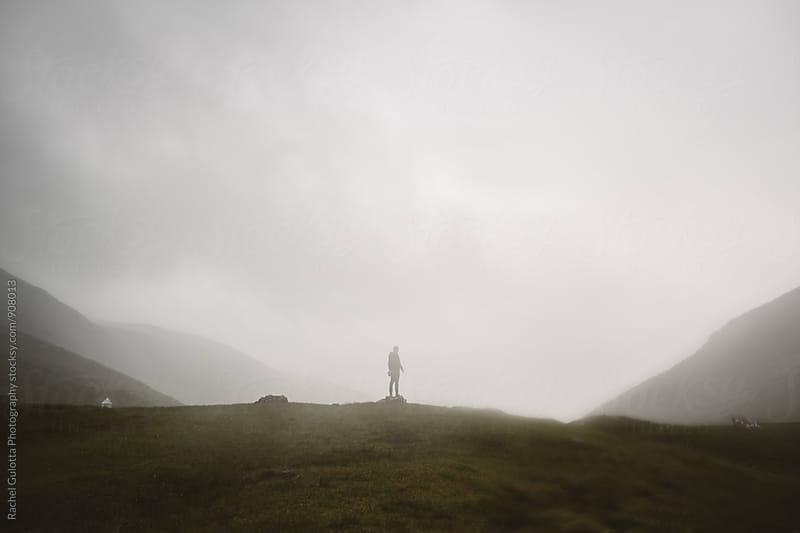 A Boy Hiding in Fog in the Faroe Islands by Rachel Gulotta Photography for Stocksy United