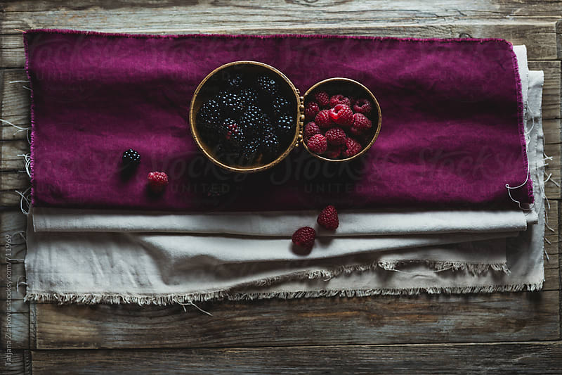 Blackberries and raspberries by Tatjana Zlatkovic for Stocksy United