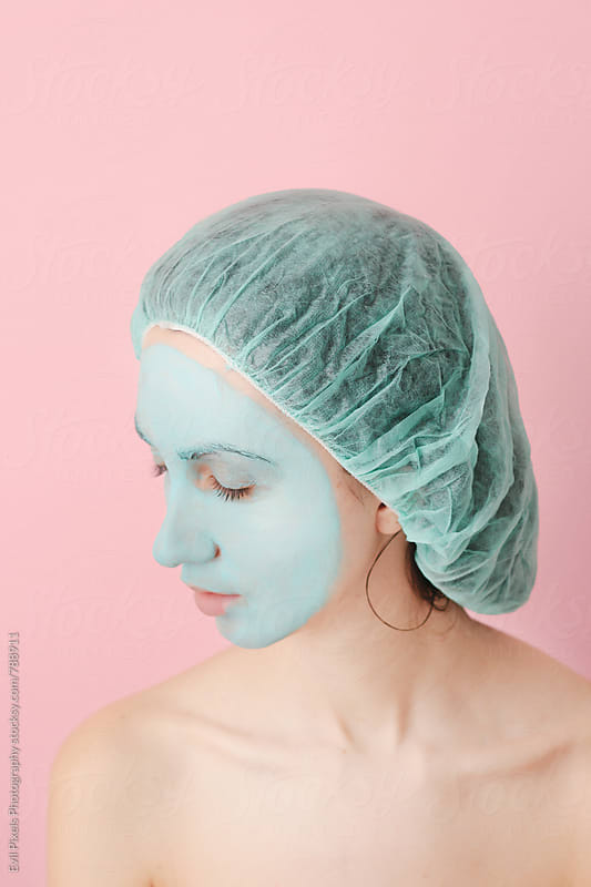 Portrait of a young woman with skin care mask by Evil Pixels Photography for Stocksy United