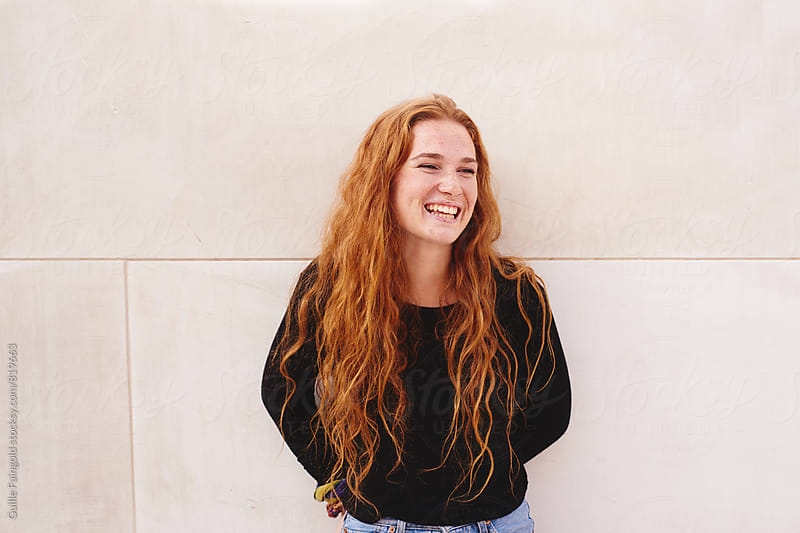 Smiling young red-haired woman by Guille Faingold for Stocksy United