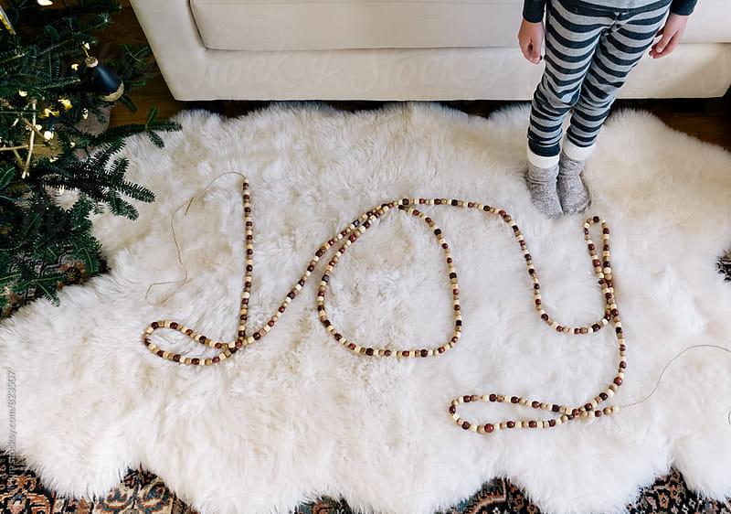 Wood garland spells JOY by Kelli Seeger Kim for Stocksy United