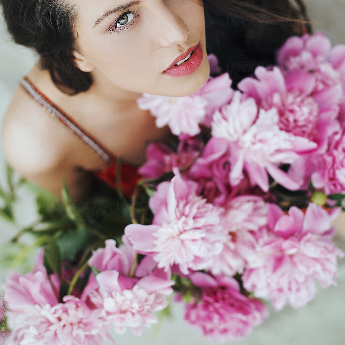 Portrait of a beautiful young woman with peonies flowers stocksy portrait of a beautiful young woman with peonies flowers by jovana rikalo for stocksy united izmirmasajfo