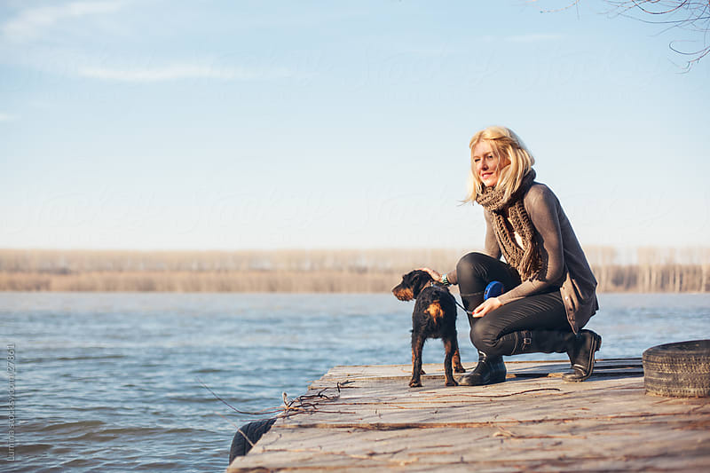 Woman and Dog Outdoors by Lumina for Stocksy United