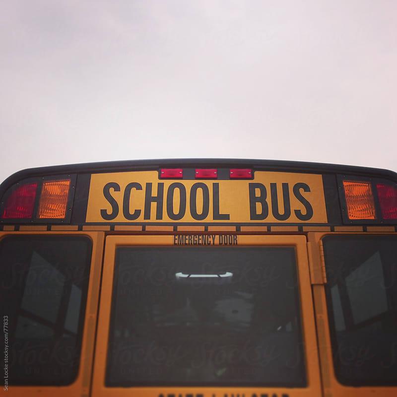 School Bus: Rear View of School Bus by Sean Locke for Stocksy United