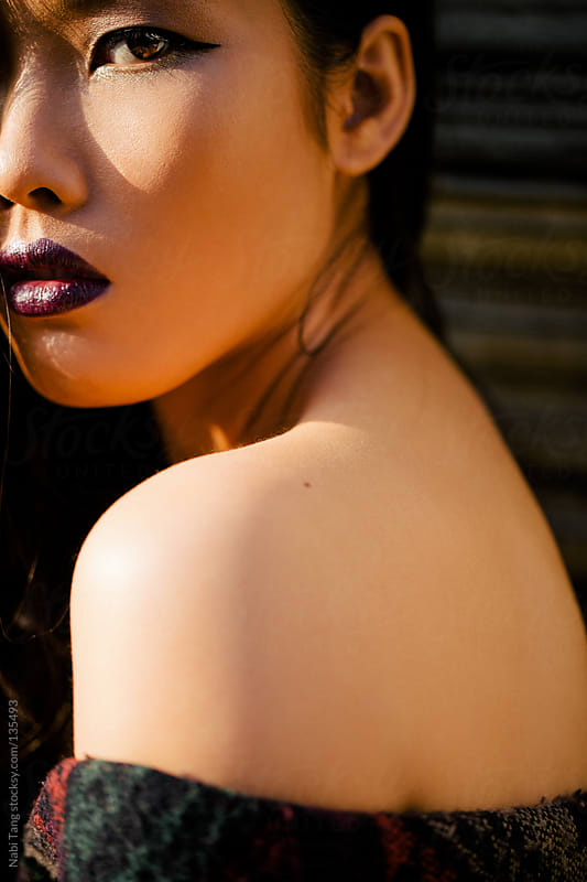 Black Liner and Purple Lipstick by Nabi Tang for Stocksy United