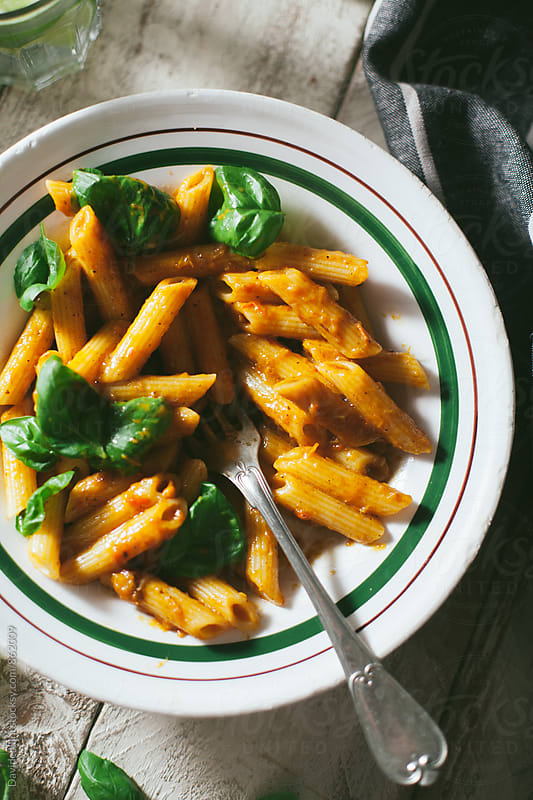 Pasta with pepper sauce and basil by Davide Illini for Stocksy United