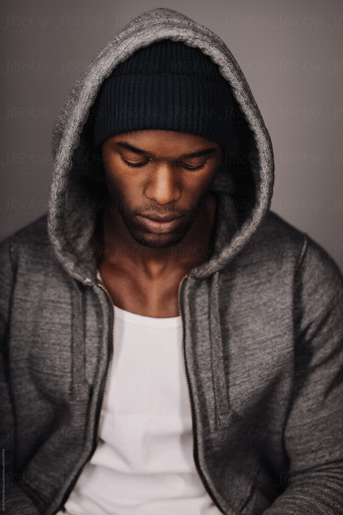 9ff9204bcbb Calm African male model in hoodie by Jacob Lund for Stocksy United