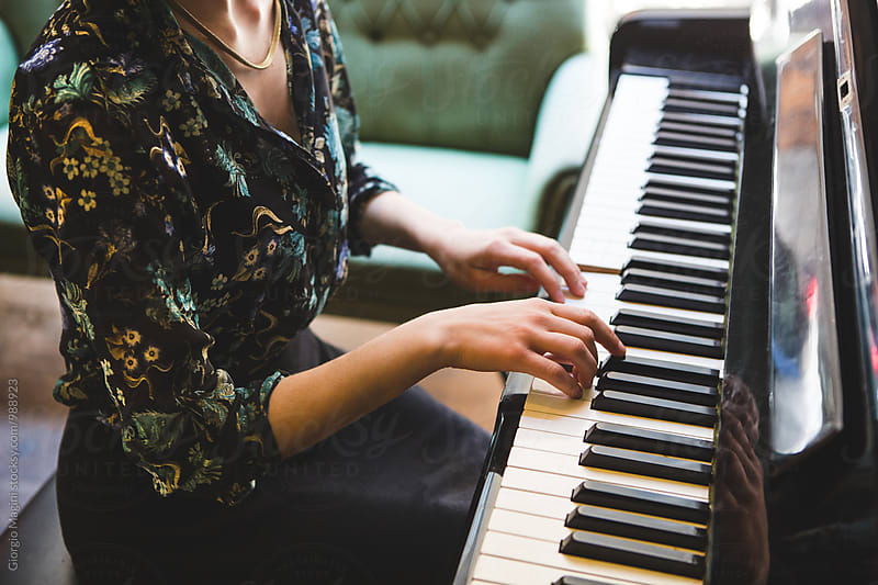 Woman with Floral Blouse Playing an Old Piano by Giorgio Magini for Stocksy United