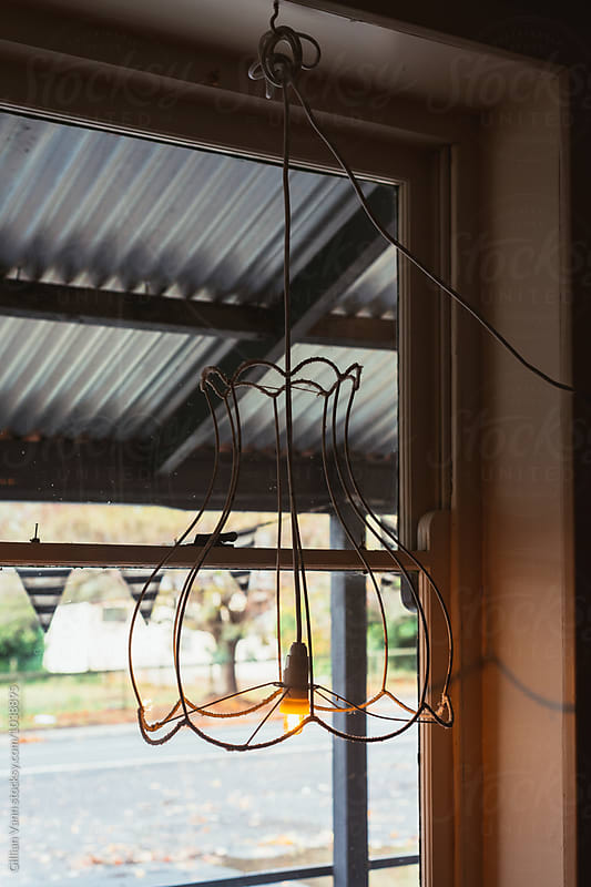 quirky light fitting with bare bulb by Gillian Vann for Stocksy United