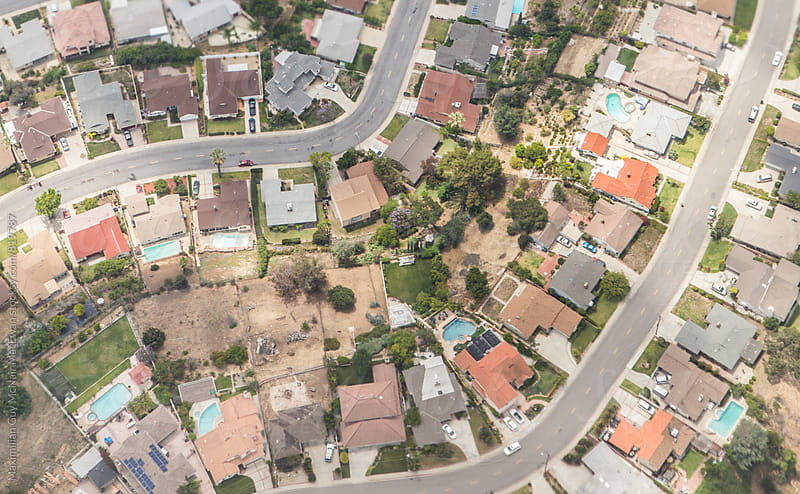 An arial view of American suburbia  by Maximilian Guy McNair MacEwan for Stocksy United