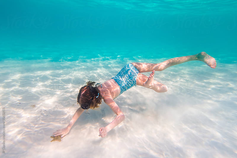 Little Girl Diving for Starfish Snorkeling Underwater at All Inclusive Caribbean Resort White Sand Beach by JP Danko for Stocksy United