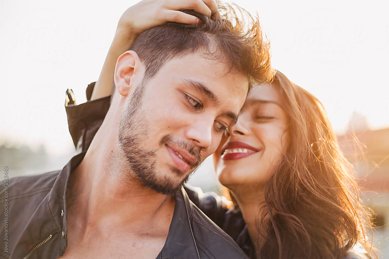 Young beautiful couple on spring sun by Jovo Jovanovic for Stocksy United