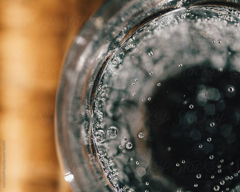 Carbonated water glass close up by Laura Stolfi for Stocksy United