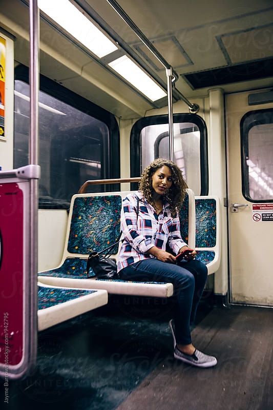 Adult Woman Riding the Subway by Jayme Burrows for Stocksy United