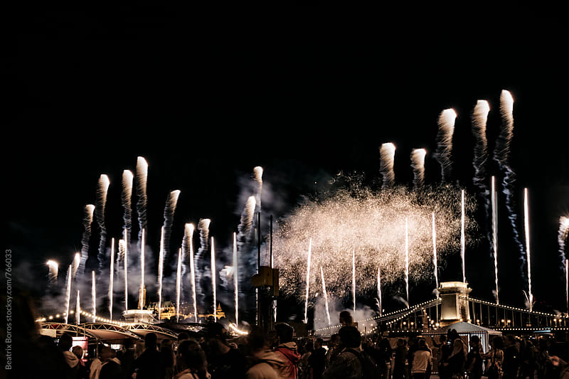 Crowd at fireworks in front of Chain Bridge, Budapest, Hungary by Beatrix Boros for Stocksy United