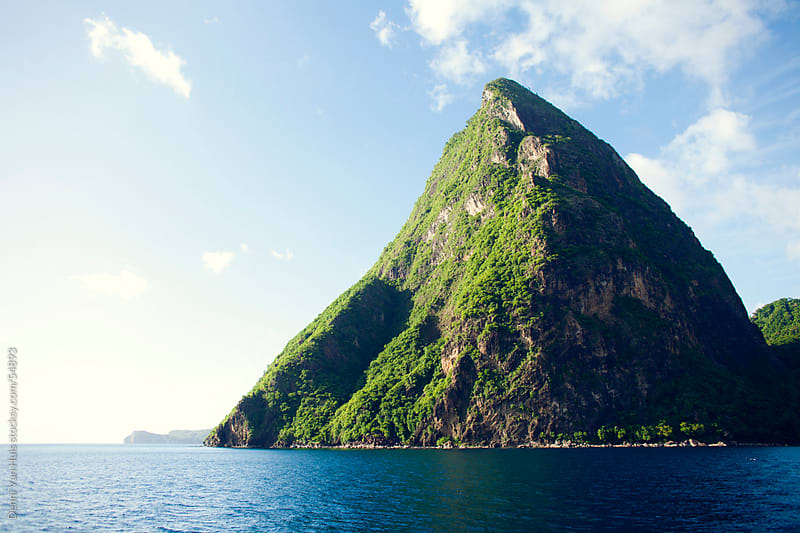Volcanic mountain rising out of the Caribbean ocean by Denni Van Huis for Stocksy United