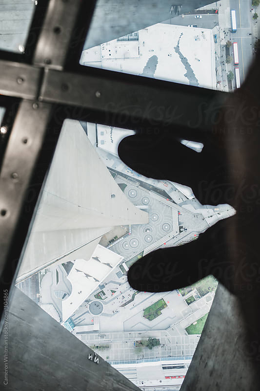 Looking down throught the glass floor in the CN tower by Cameron Whitman for Stocksy United