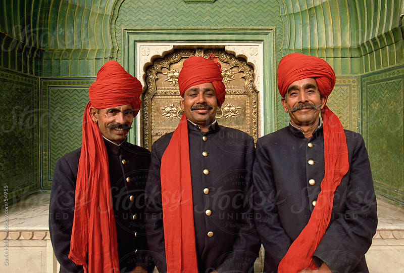 Palace guards in turbans at the ornate Peacock Gateway, City Palace, Jaipur, Rajasthan state, India by Gavin Hellier for Stocksy United