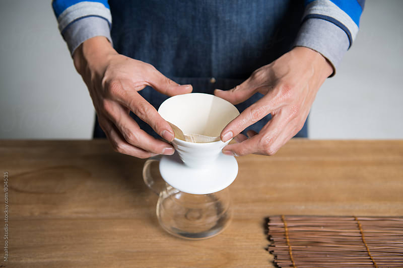 Man putting coffee filter by MaaHoo Studio for Stocksy United