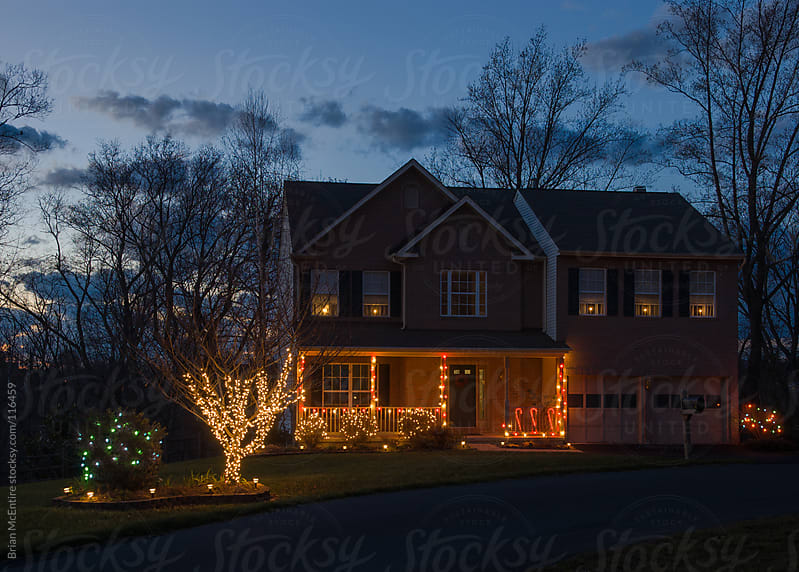 Typical American Home with Christmas Lights and Electric Window  by Brian McEntire for Stocksy United