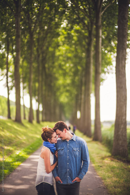 couple along a path by Sam Hurd Photography for Stocksy United