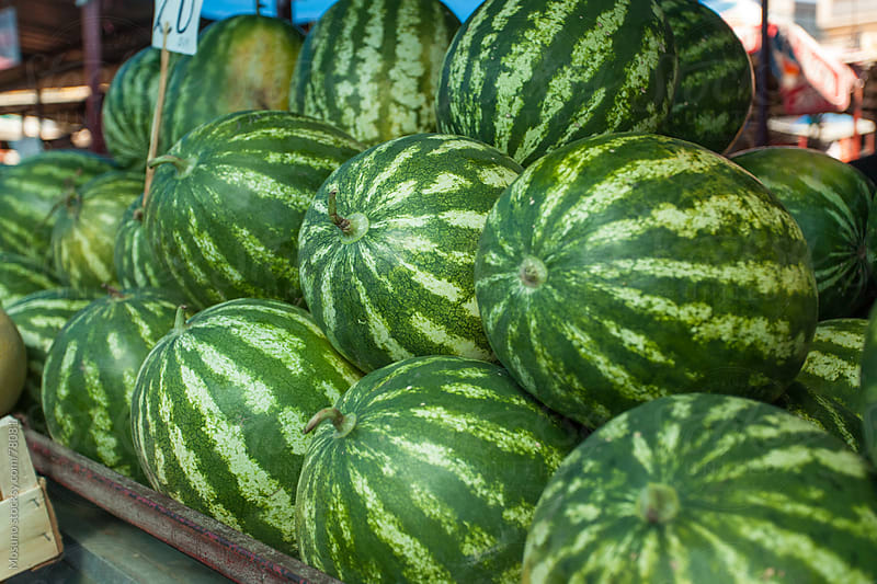 Organic watermelons on a market. by Mosuno for Stocksy United