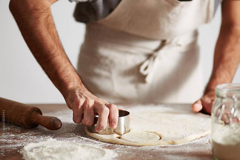 Preparing English Muffins by Martí Sans for Stocksy United