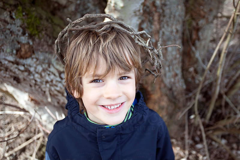 Boy wearing a crown of sticks by Carleton Photography for Stocksy United