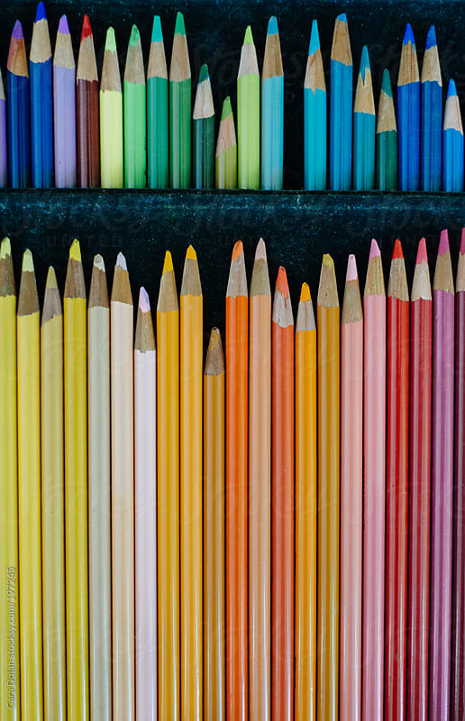 Colored pencils arranged by color by Cara Dolan for Stocksy United
