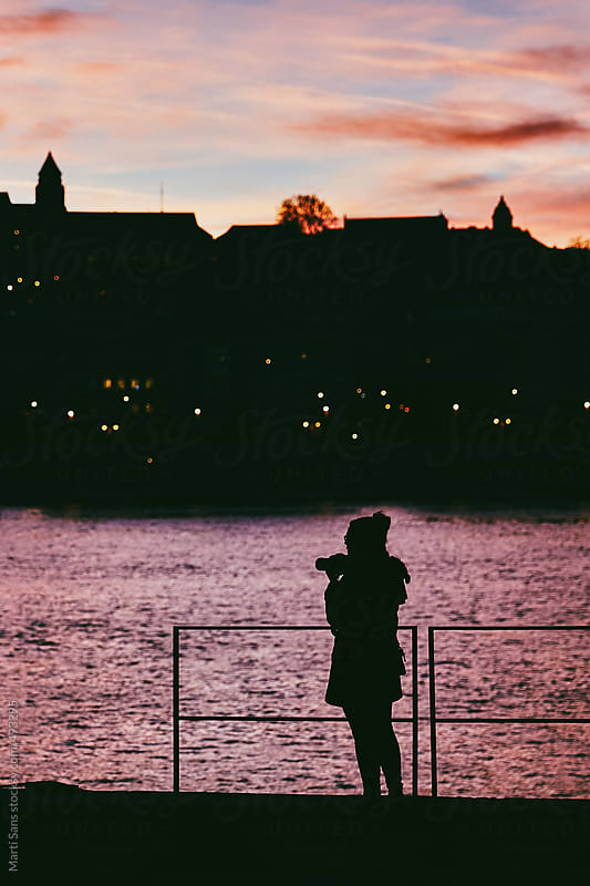 Tourist taking photo of Budapest skyline at sunset by Martí Sans for Stocksy United