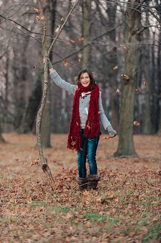 Playing in the woods by Melanie DeFazio for Stocksy United