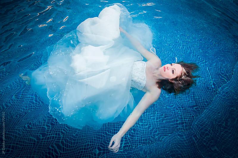 Trash the Dress Bride Floating in Wedding Dress by JP Danko for Stocksy United