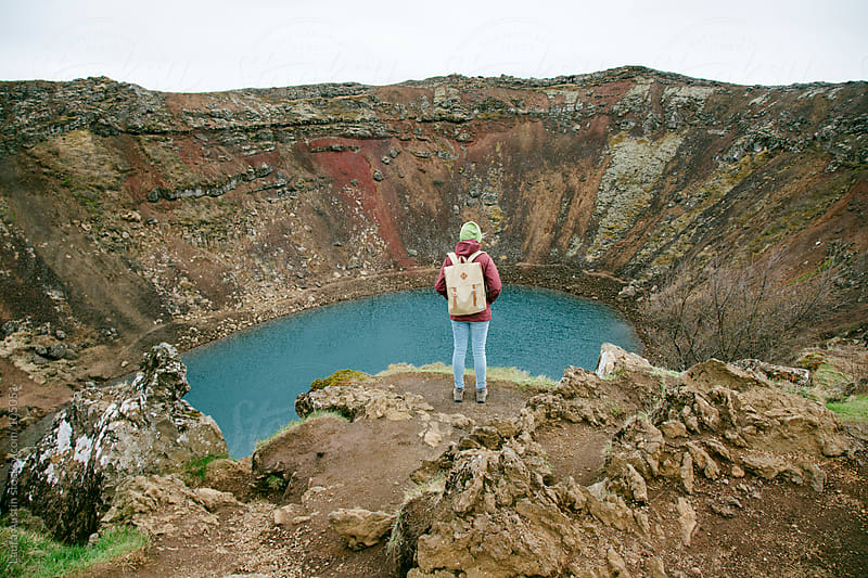 Hiker Standing in Front Of A Large Crater In Iceland by Laura Austin for Stocksy United