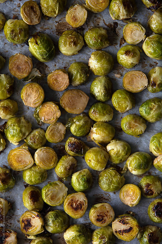Oven-roasted Brussels sprouts by Pixel Stories for Stocksy United