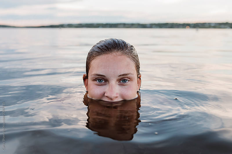 Young woman submerged in water by Carey Shaw for Stocksy United