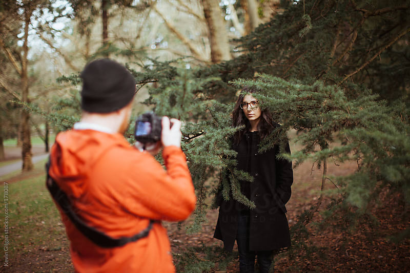 Man Taking Photo of Woman by Kevin Gilgan for Stocksy United