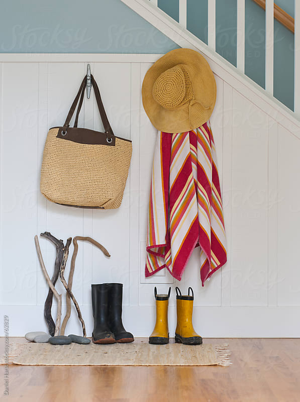 Coastal objects hanging in entry way by Daniel Hurst for Stocksy United