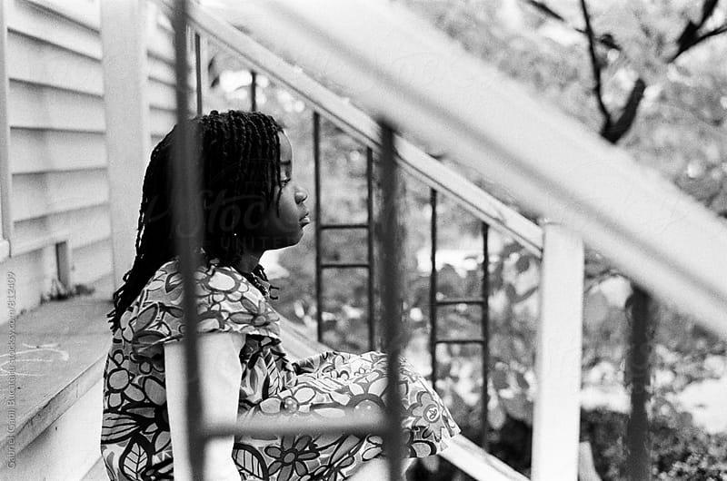 African American girl sitting on the steps by Gabriel (Gabi) Bucataru for Stocksy United