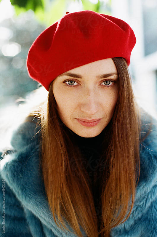 Portrait of beautiful woman wearing beret by Lyuba Burakova for Stocksy United