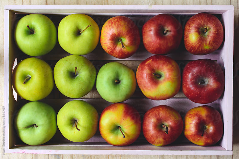 Colorful apples by Pixel Stories for Stocksy United