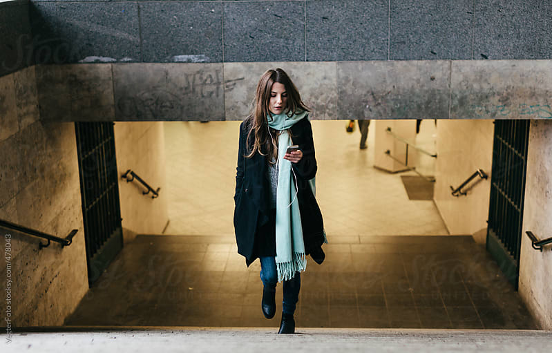 Woman leaving Subway Station by VegterFoto for Stocksy United