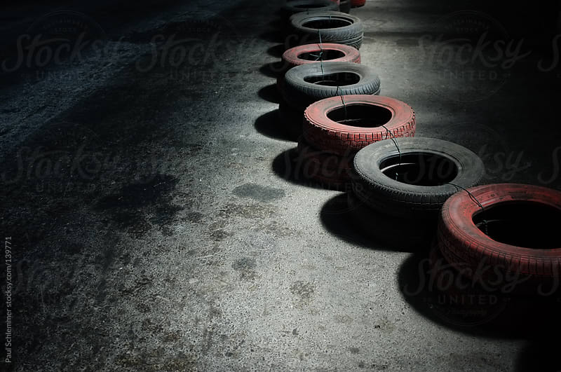tires on a racing circuit by Paul Schlemmer for Stocksy United