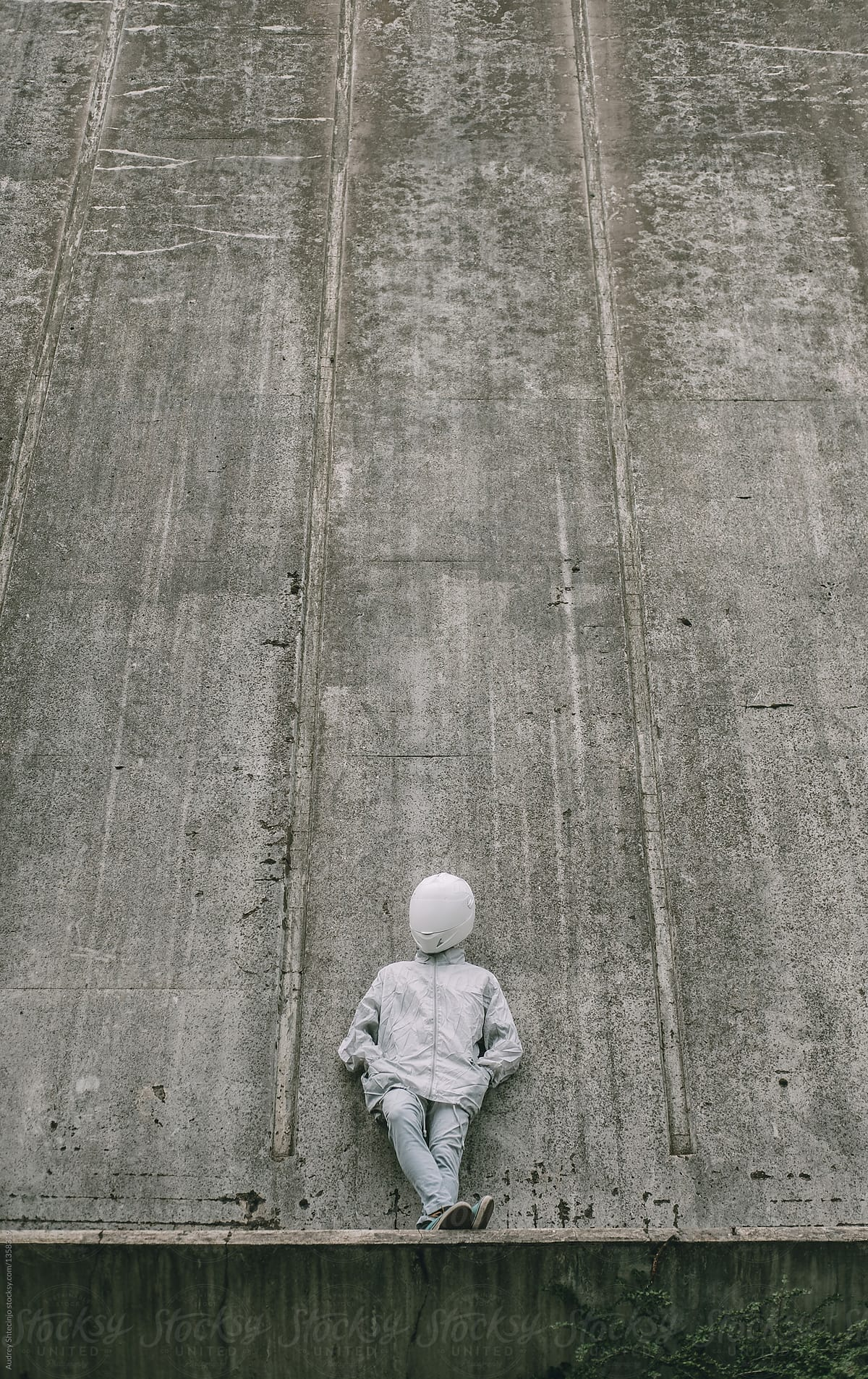 Stock Photo - Abstract Scene With Person With White Helmet/Mask And Silver  Jacket