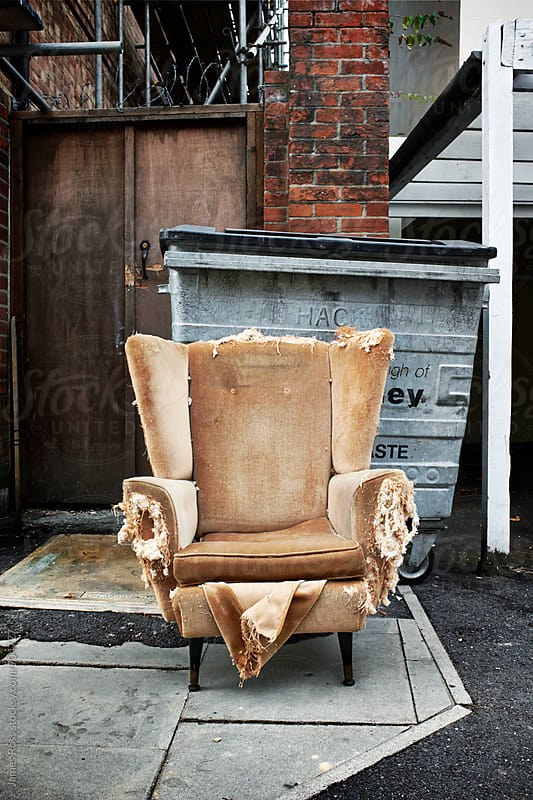 A distressed armchair by James Ross for Stocksy United