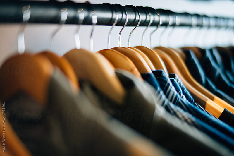 Shallow Depth of Field Photo of Men's Shirts Hanging on a Rack by Austin Rogers for Stocksy United