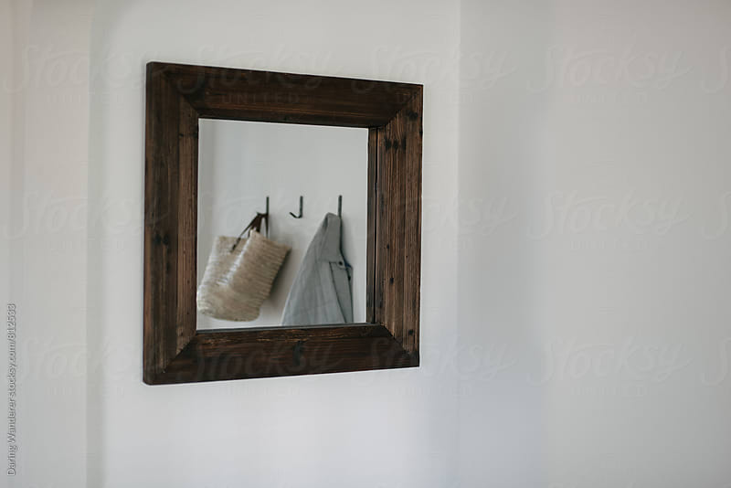Reflection of market tote bag and jacket in home entrance way by Daring Wanderer for Stocksy United